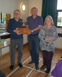 Stephen A Rossiter, the Reading team captain receiving the trophy from judges